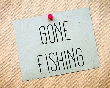 gone: Recycled paper note pinned on cork board. Gone Fishing Message. Concept Image