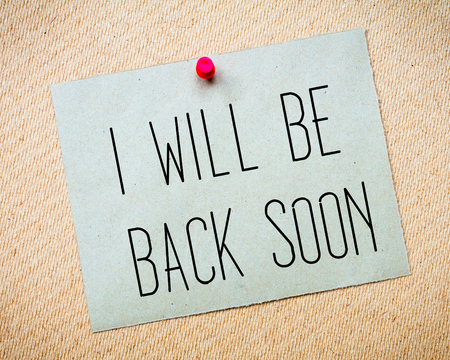 billboard posting: Recycled paper note pinned on cork board. I will be back soon Message. Concept Image Stock Photo