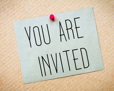 invited: Recycled paper note pinned on cork board. You Are Invited Message. Concept Image Stock Photo