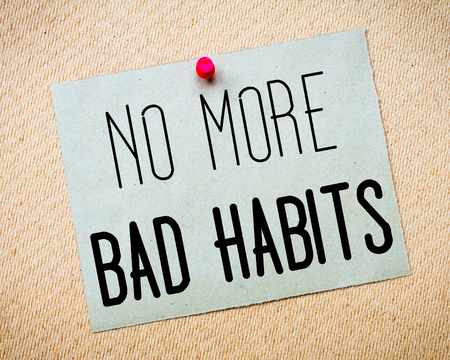 bad habits: Recycled paper note pinned on cork board. No More Bad Habits Message. Concept Image Stock Photo