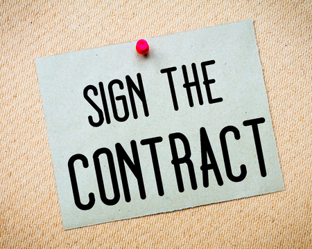 billboard posting: Recycled paper note pinned on cork board. Sign the contract Message. Concept Image Stock Photo