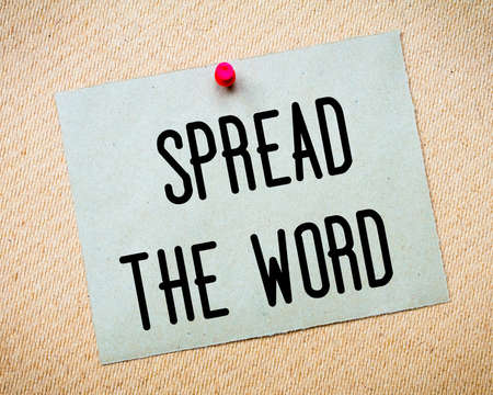 billboard posting: Recycled paper note pinned on cork board. Spread the Word Message. Concept Image