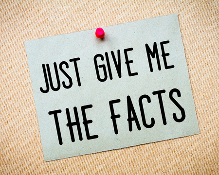 billboard posting: Recycled paper note pinned on cork board. Just give me the facts Message. Concept Image Stock Photo