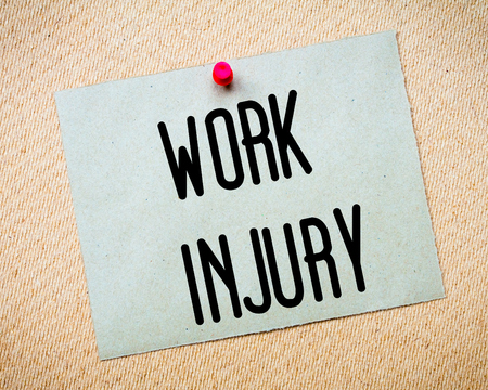 billboard posting: Recycled paper note pinned on cork board. Work Injury Message. Concept Image