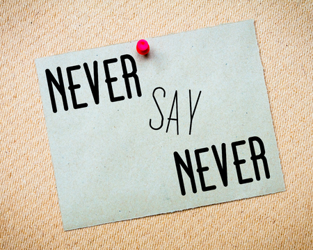 billboard posting: Recycled paper note pinned on cork board. Never Say Never Message. Concept Image Stock Photo