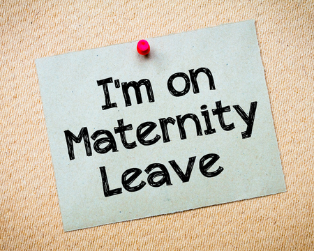 maternity leave: Recycled paper note pinned on cork board.