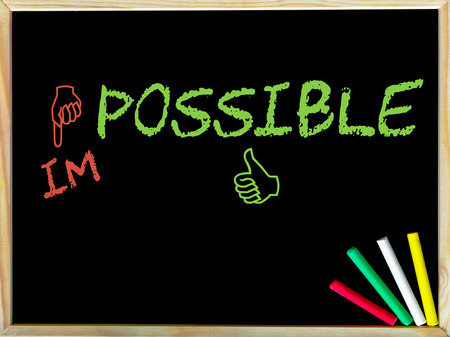changed: Impossible word changed into possible by red and green hand signs.