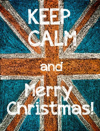 Keep Calm and Merry Christmas on United Kingdom (British Union jack) flag, vintage hand drawing with chalk on blackboard photo