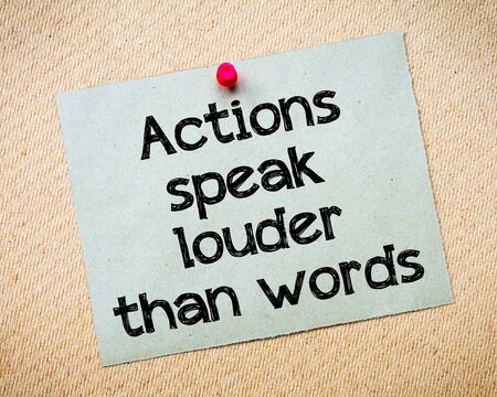 louder: Actions speak louder than words Message. Recycled paper note pinned on cork board. Concept Image