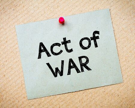 idioms: Act of War Message. Recycled paper note pinned on cork board. Concept Image