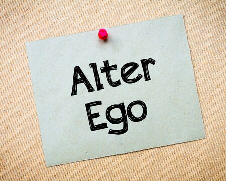 alter ego: Alter Ego Message. Recycled paper note pinned on cork board. Concept Image