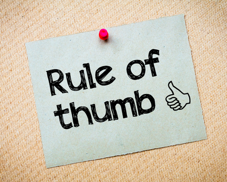 thumb: Rule of Thumb Message. Recycled paper note pinned on cork board. Concept Image