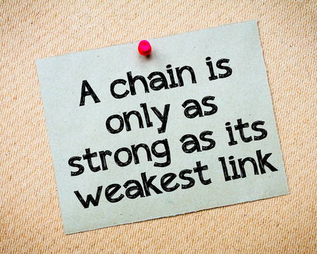 weakest: A chain is only as strong as its weakest link Message. Recycled paper note pinned on cork board. Concept Image Stock Photo