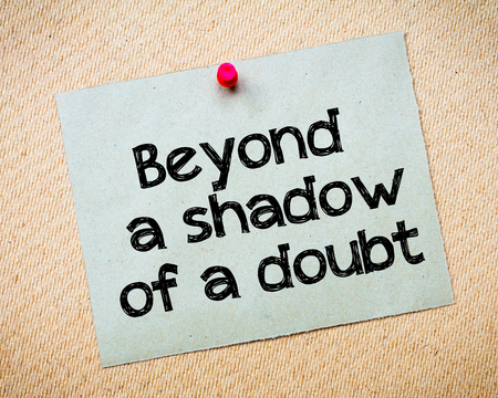 beyond: Beyond a shadow of a doubt Message. Recycled paper note pinned on cork board. Concept Image Stock Photo