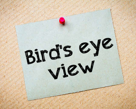 Birds eye view Message. Recycled paper note pinned on cork board. Concept Image