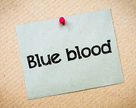 idioms: Blue blood Message. Recycled paper note pinned on cork board. Concept Image Stock Photo