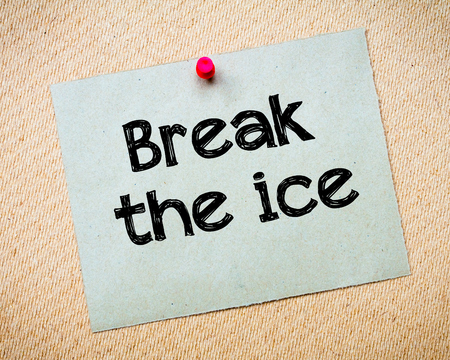 idioms: Break the ice Message. Recycled paper note pinned on cork board. Concept Image Stock Photo