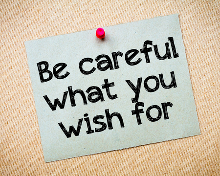 be careful: Be careful what you wish for Message. Recycled paper note pinned on cork board. Concept Image Stock Photo