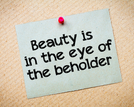 beholder: Beauty is in the eye of the beholder Message. Recycled paper note pinned on cork board. Concept Image