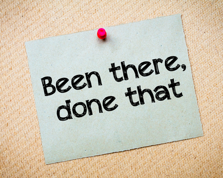 that: Been there, done that Message. Recycled paper note pinned on cork board. Concept Image Stock Photo