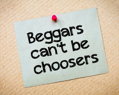 cant: Beggars cant be choosers Message. Recycled paper note pinned on cork board. Concept Image Stock Photo
