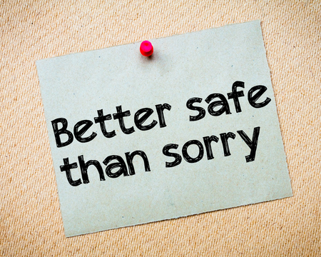idioms: Better safe than sorry Message. Recycled paper note pinned on cork board. Concept Image