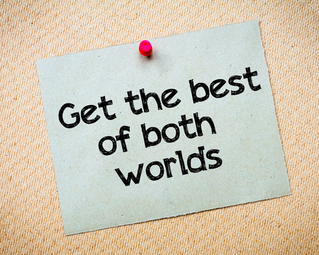 Get the best of both worlds Message. Recycled paper note pinned on cork board. Concept Image
