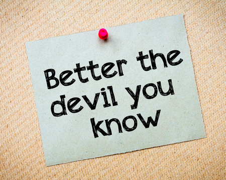 better: Better the devil you know Message. Recycled paper note pinned on cork board. Concept Image