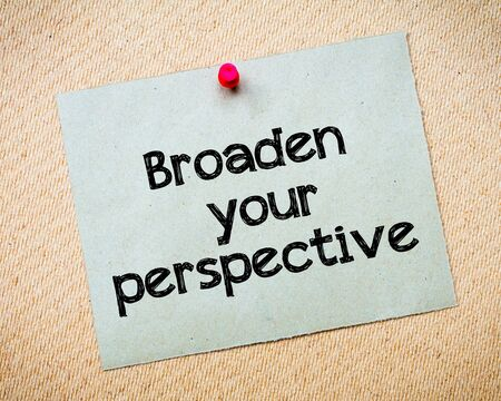broaden: Broaden your perspective Message. Recycled paper note pinned on cork board. Concept Image Stock Photo