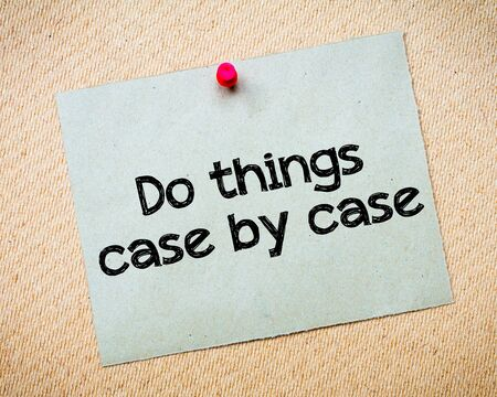 things to do: Do things case by case Message. Recycled paper note pinned on cork board. Concept Image Stock Photo