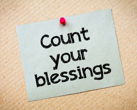 Count your blessings Message. Recycled paper note pinned on cork board. Concept Image