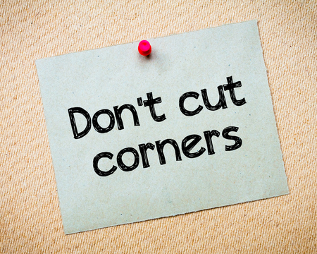 no integrity: Dont cut corners Message. Recycled paper note pinned on cork board. Concept Image Stock Photo