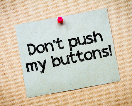 Dont push my buttons! Message. Recycled paper note pinned on cork board. Concept Image Stock Photo