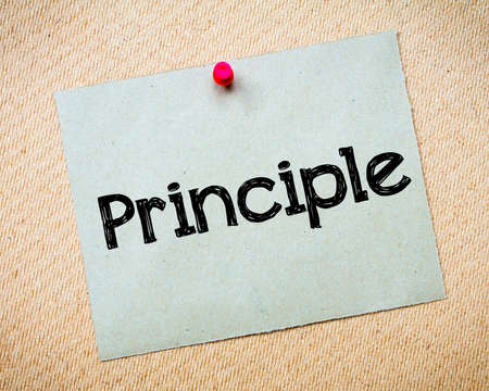 principle: Principle Message. Recycled paper note pinned on cork board. Concept Image