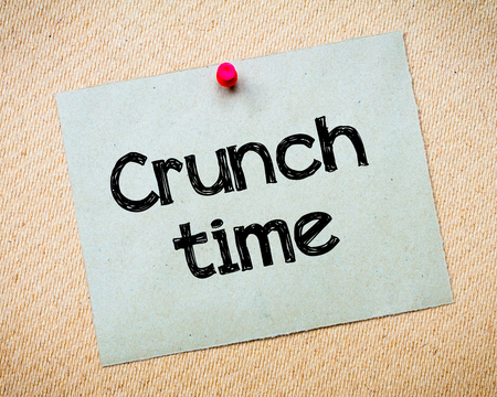crunch: Crunch Time Message. Recycled paper note pinned on cork board. Concept Image Stock Photo