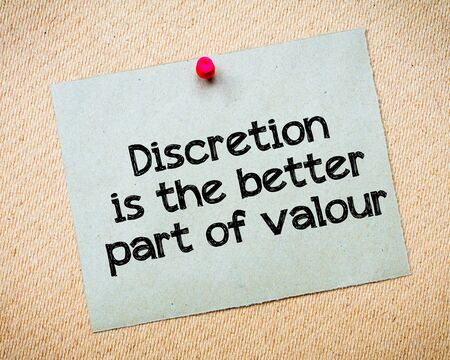 discretion: Discretion is the better part of valour Message. Recycled paper note pinned on cork board. Concept Image