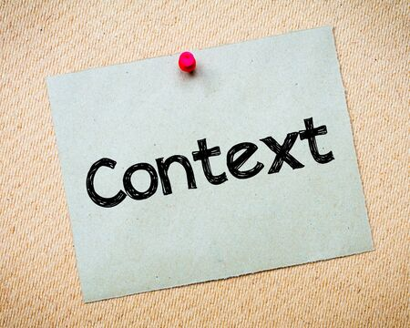 context: Context Message. Recycled paper note pinned on cork board. Concept Image Stock Photo