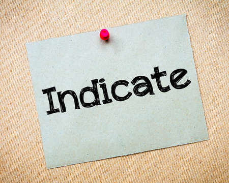 indicate: Indicate Message. Recycled paper note pinned on cork board. Concept Image