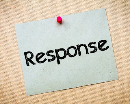idioms: Response Message. Recycled paper note pinned on cork board. Concept Image