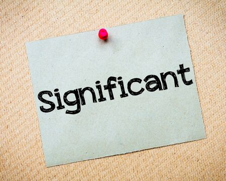 significant: Significant Message. Recycled paper note pinned on cork board. Concept Image