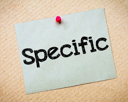 specific: Specific Message. Recycled paper note pinned on cork board. Concept Image Stock Photo