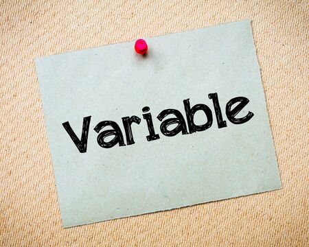 variable: Variable Message. Recycled paper note pinned on cork board. Concept Image