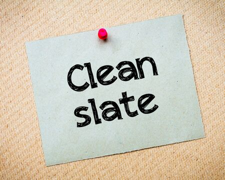 idioms: Clean Slate Message. Recycled paper note pinned on cork board. Concept Image