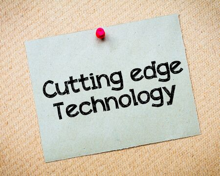 cutting edge: Cutting Edge Technology Message. Recycled paper note pinned on cork board. Concept Image Stock Photo