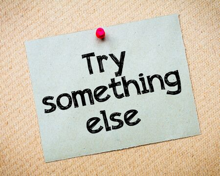 else: Try something else Message. Recycled paper note pinned on cork board. Concept Image Stock Photo