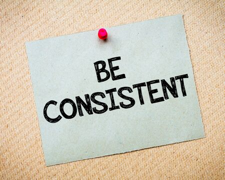 Be Consistent Message. Recycled paper note pinned on cork board. Concept Image Stock fotó