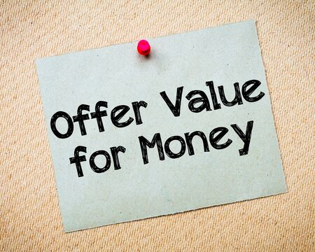 idioms: Offer Value for Money Message. Recycled paper note pinned on cork board. Concept Image Stock Photo
