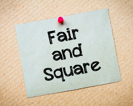 idioms: Fair and Square Message. Recycled paper note pinned on cork board. Concept Image