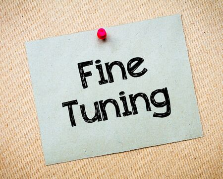 tuning: Fine Tuning Message. Recycled paper note pinned on cork board. Concept Image