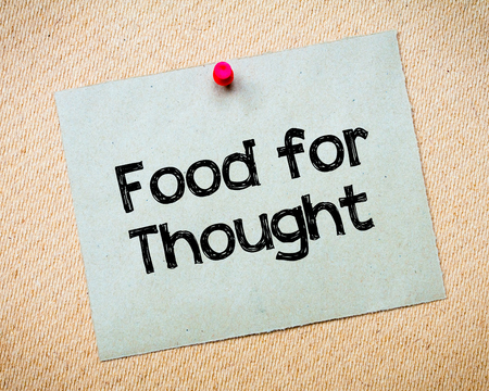 Food for Thought Message. Recycled paper note pinned on cork board. Concept Image Stock Photo
